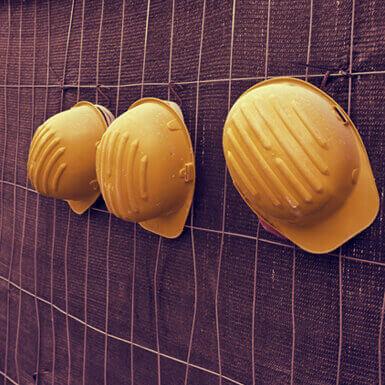 Three yellow hard hats
